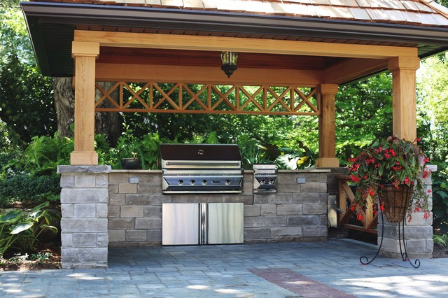 Backyard Grilling Areas  Covered BBQ Area with Natural Stone Counters Traditional
