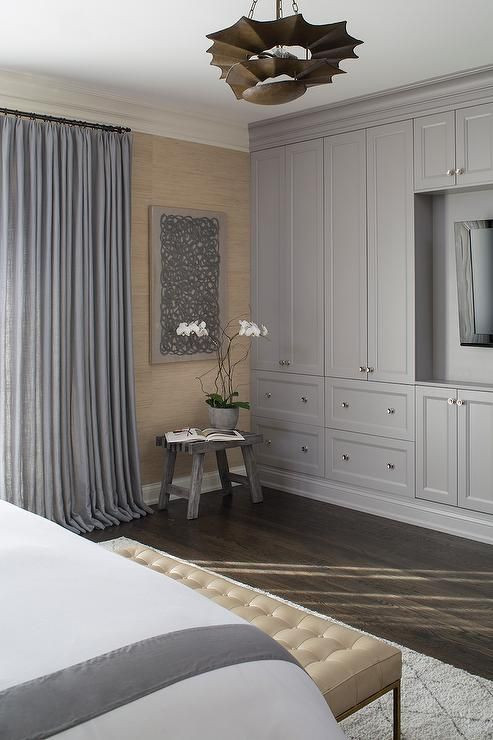 Bedroom Wall Storage Cabinets  Master bedroom features a wall of gray built in cabinets