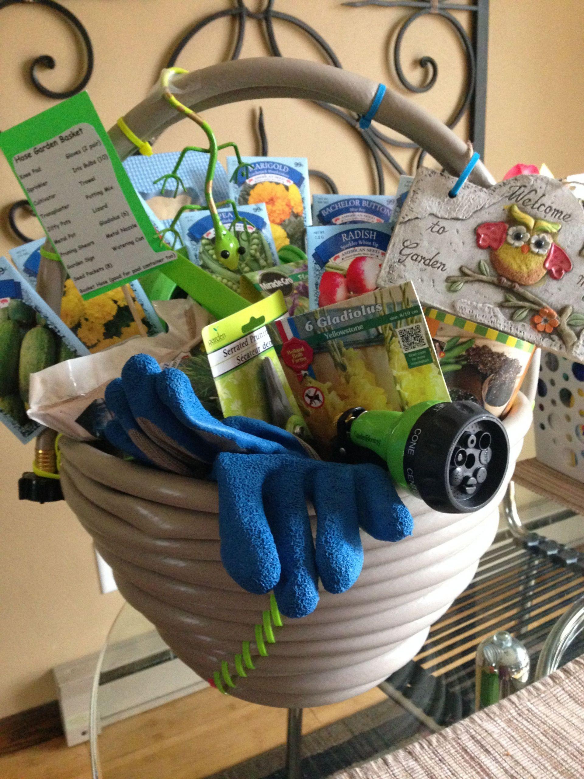 Garden Themed Gift Basket Ideas  Garden hose basket For a fundraiser