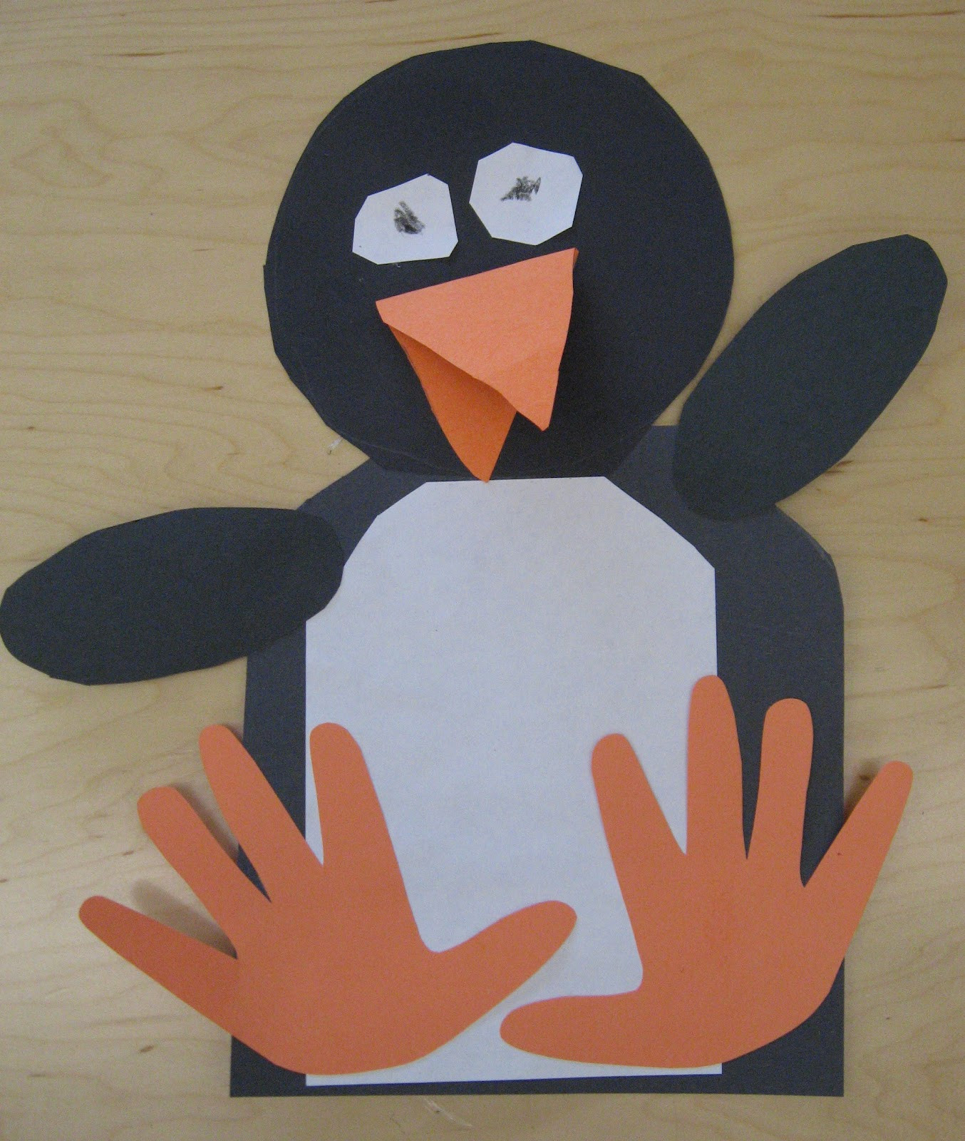 Penguin Craft For Preschoolers  handprint penguins rubber boots and elf shoes