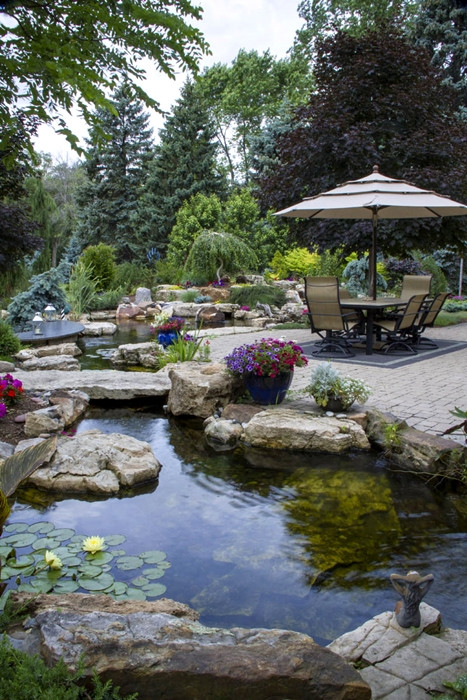 Pond In Backyard  Create a Paradise with a Backyard Pond Town & Country Living