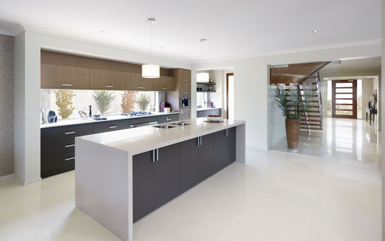 White Kitchen Bench  White waterfall bench top with grey cupboards